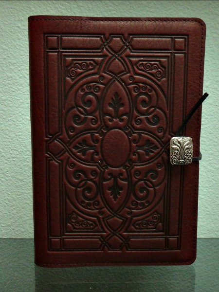 Handcrafted oberon leather journal, Smythe Sewn with recycled, heavy bond, acid free paper, simple, durable bootlace thong wraps around a matching Metal button.