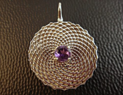 To me this Sunflower Amethyst represents the never-ending circles of life and spirit. The subtle attention to detail creates a 3 dimensional flow.
