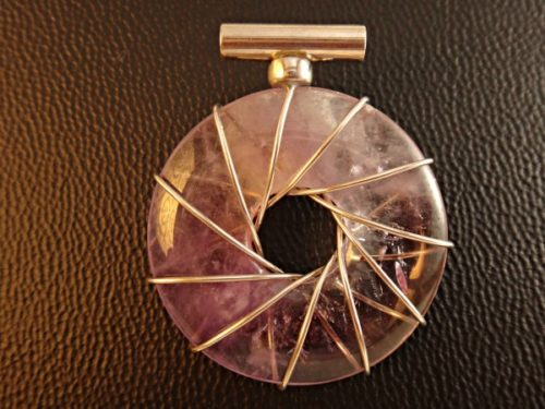 Amethyst Vortex-This stunning Amethyst Vortex Pendant will gently nudge you towards creating the life of your dreams - infused with a variety of healing energies.