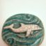 "This Raku Medallion Dolphin makes the perfect small and affordable gift for all dolphin lovers!  On the back is inscribed ""I am playful.""  The dolphin as a spirit animal represents harmony, balance, & play."